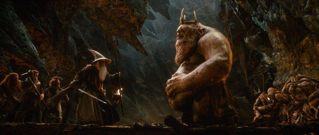 """(L-r) PETER HAMBLETON as Gloin, Adam Brown as Ori, Jed Brophy as Nori, IAN McKELLEN (center) as Gandalf and the Great Goblin, performed by BARRY HUMPHRIES in the fantasy adventure """"THE HOBBIT: AN UNEXPECTED JOURNEY,"""" a production of New Line Cinema and Metro-Goldwyn-Mayer Pictures (MGM), released by Warner Bros. Pictures and MGM."""