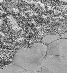 Плутон: обледеневшая Равнина Спутника и горы