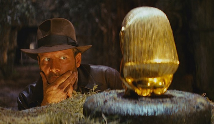 "Archeologist Indiana Jones eyes a golden idol in the remastered Imax version of ""Raiders of the Lost Ark"" being released September 7, 2012 in selected theaters. (Lucasfilm/MCT)"